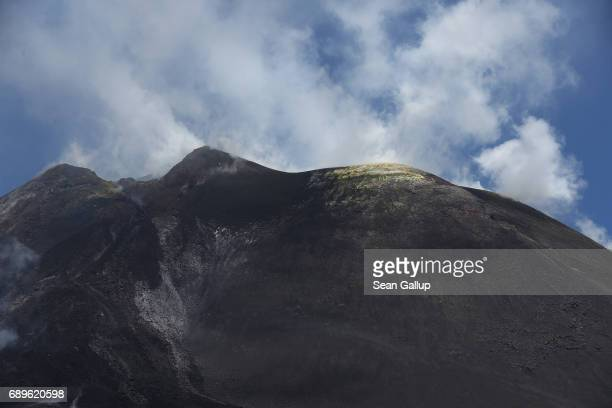 Rising steam and clouds mix at the peak of Mount Etna on the island of Sicily on May 28 2017 near Catania Italy Mount Etna is among the world's most...