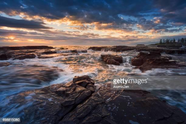 Rising sun at Kiama surf beach, South of Sydney, Australia