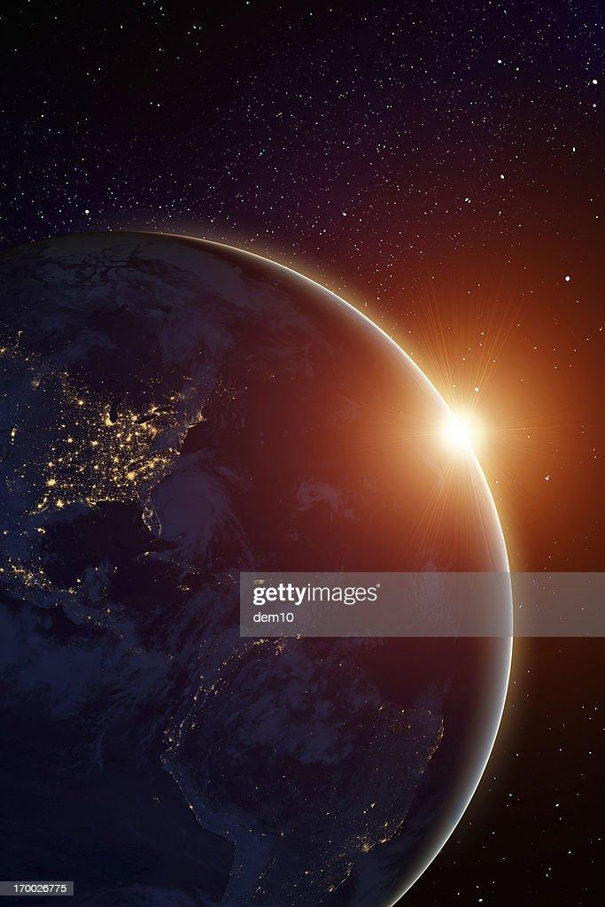 Rising sun behind planet : Stock Photo