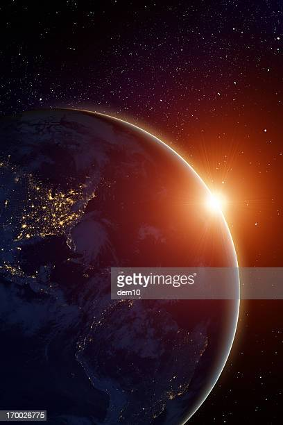 Rising sun behind planet