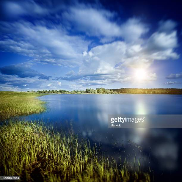 Rising sun over lake