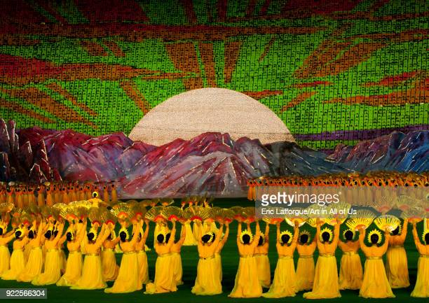 Rising sun over mount Paektu made by children pixels holding up colored boards during Arirang mass games in may day stadium Pyongan Province...