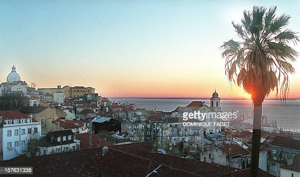 Rising sun over the old district of Alfama in Lisbon 25 February Expo '98 the last world's fair of the millenium which centers on the theme 'oceans...
