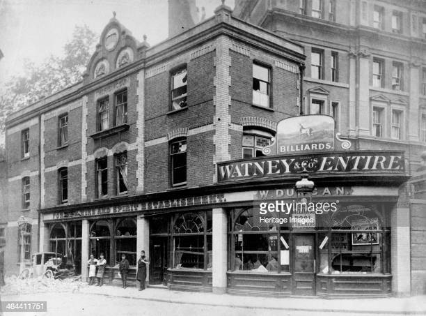 Rising Sun public house Great Scotland Yard London with windows blown in after a Fenian bomb attack Four men stand outside the building and a pile of...