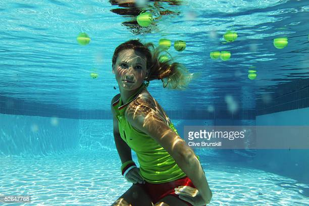 Rising tennis star 17year old Tatiana Golovin of France plays tennis underwater at the Ocean Club on April 1 2005 on Key Biscayne in Miami Florida