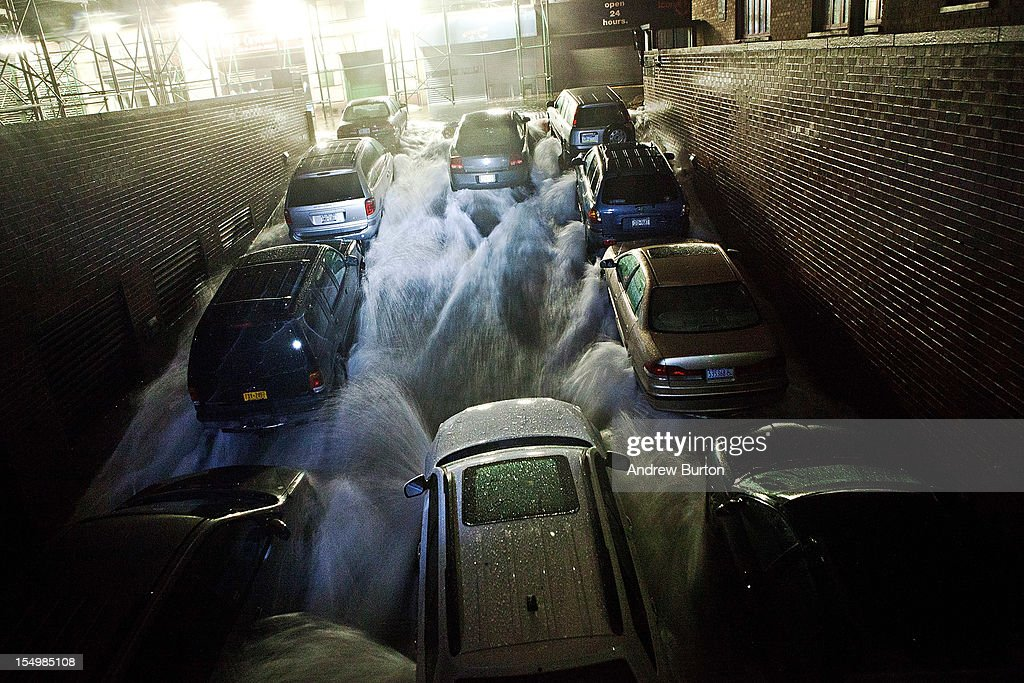 Rising water, caused by Hurricane Sandy, rushes into a subterranian parking garage on October 29, 2012, in the Financial District of New York, United States. Hurricane Sandy, which threatens 50 million people in the eastern third of the U.S., is expected to bring days of rain, high winds and possibly heavy snow. New York Governor Andrew Cuomo announced the closure of all New York City will bus, subway and commuter rail service as of Sunday evening