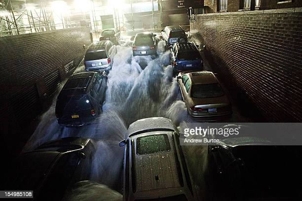 Rising water caused by Hurricane Sandy rushes into a subterranian parking garage on October 29 in the Financial District of New York United States...