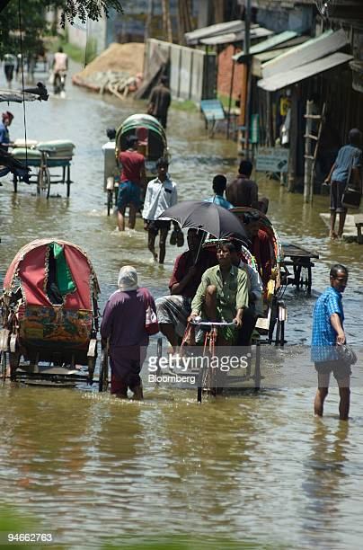 Rising waters flood a street in Demra on the outskirts of Dhaka Bangladesh on Sunday August 5 2007 The United Nations warned of a food crisis across...