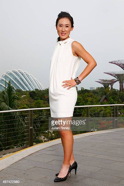 Rising WTA stars Saisai Zheng of China poses for a photo during previews for the WTA Finals at Marina Bay Sands Hotel on October 18 2014 in Singapore