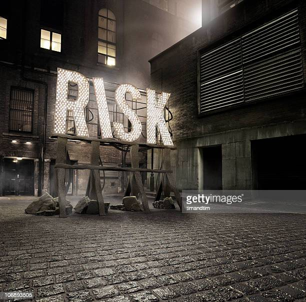 risk in the alley - warning sign stock pictures, royalty-free photos & images