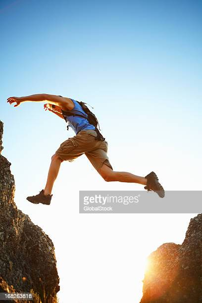 A risk taker jumping over the rocks