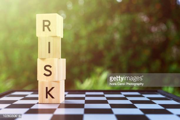 risk word on wooden block - risk stock pictures, royalty-free photos & images