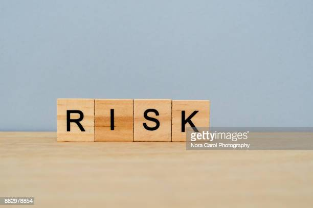 Risk Word on Wooden Tile Block