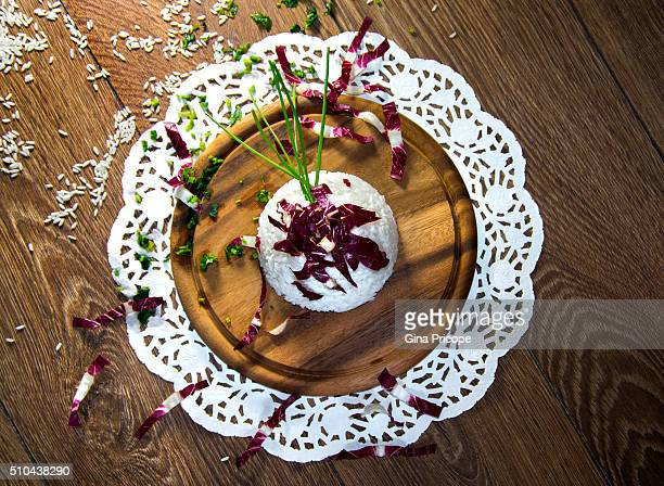 Risotto and radicchio on a wooden board.