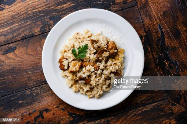Risotto with porcini mushroom serving size on wooden table