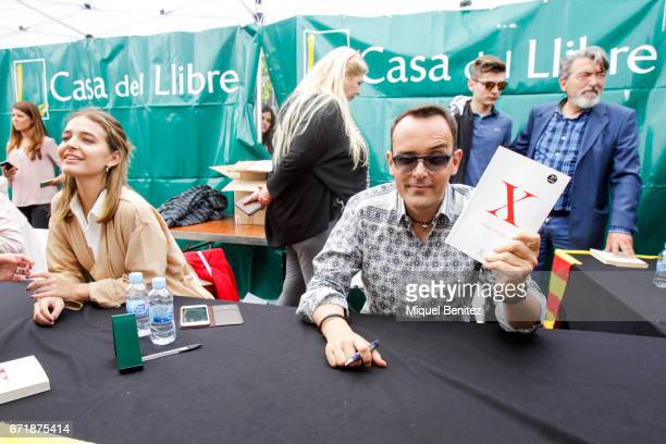 Risto Mejide signing hi latest 'X' book and Laura Escanes during 'Sant Jordi's Day' 'Saint George's Day' at Passeig de Gracia boulevard on April 23...