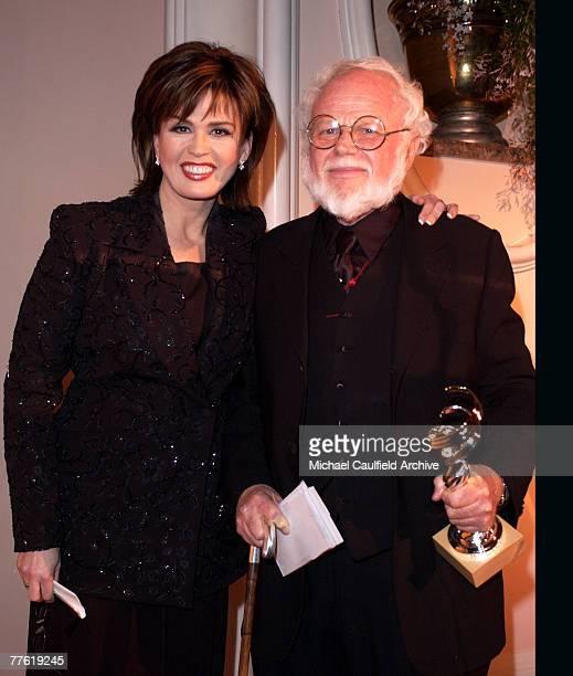 Rit Color Career Achievement Award for Television winner costume designer Ret Turner alongside presenter Marie Osmond