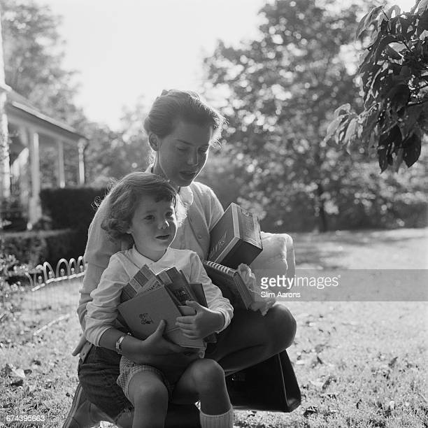 Rita Aarons wife of photographer Slim Aarons with their daughter Mary in Bedford New York circa 1960
