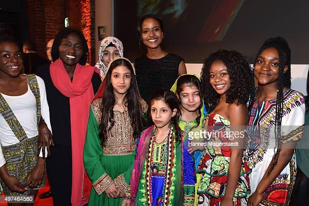Rita Auma Obama and children during the 'Prix Courage Award 2015' at Allerheiligen Hofkirche on November 16 2015 in Munich Germany