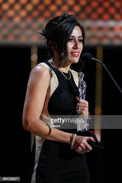 Rita Basulto receives the Ariel award during the 56th Ariel Awards Ceremony at Palace of Fine Arts on May 27 2014 in Mexico City Mexico