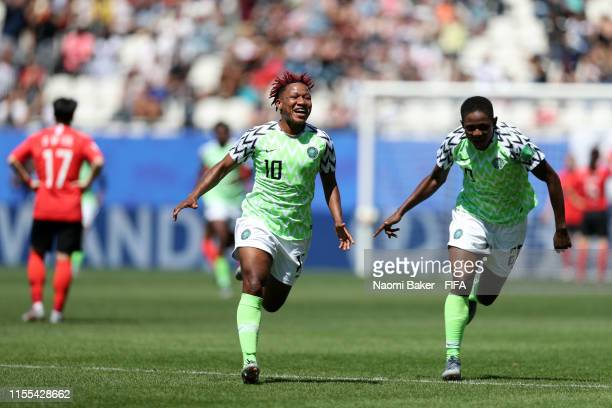 Rita Chikwelu of Nigeria celebrates after Doyeon Kim of Korea Republic scores an own goal, Nigeria's first goal during the 2019 FIFA Women's World...