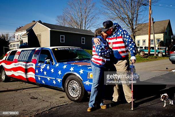 Rita Dearborn and her husband Larry share a kiss as they stand at the front of his 1997 Lincoln Town Car Limousine that they drive around the state...