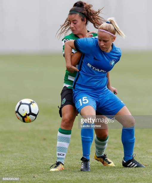 Rita Fontemanha of Sporting CP fights for the ball with Zsuzsanna Szabo of MTK Hungaria FC during the UEFA Women's Champions League Qualifying match...