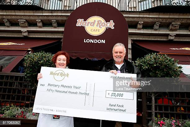 Rita Gilligan and Queen's Roger Taylor accepts £50000 cheque donated from the Hard Rock Cafe to the Mercury Phoenix Trust at Hard Rock Cafe Old Park...