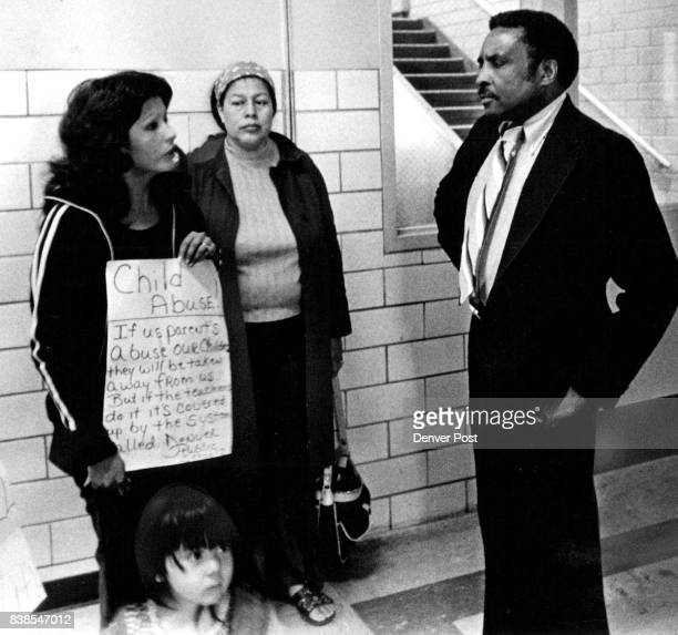 """Rita Giron, Left, And Another Parent Talk With Jim Daniels Mrs. Giron accused teaches of """"twisting my son's neck, slapping his face."""" Credit: Denver..."""