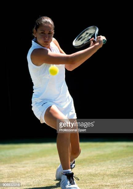 Rita Grande of Italy in action during the Wimbledon Lawn Tennis Championships at the All England Lawn Tennis and Croquet Club circa June 2002 in...