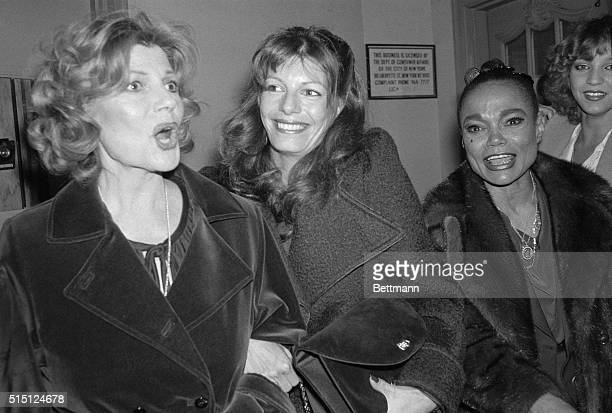 Rita Hayworth and daughter Yasmin Kahn with Eartha Kitt in the lobby of the Mark Hellinger Theatre to catch the opening of their old friend Ann...