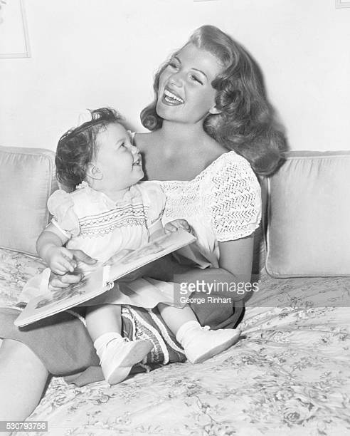 Rita Hayworth and her 16monthold daughter Rebecca whose father is Orson Welles
