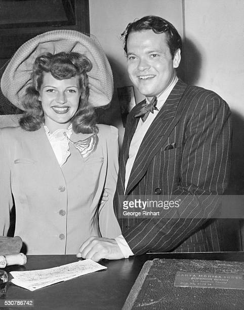 Rita Hayworth and Orson Welles beam for the cameraman as they wait their turn at the marriage license bureau in Santa Monica, California, just prior...