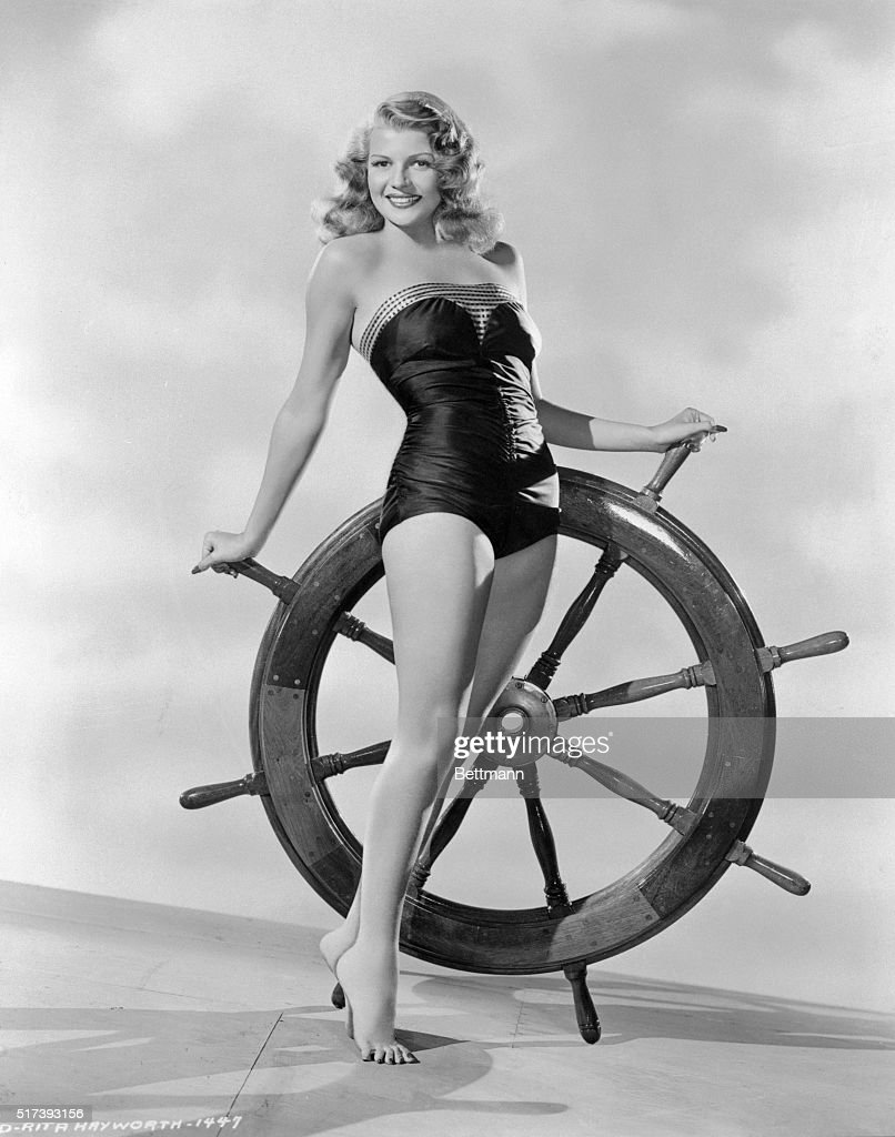 Rita Hayworth and Ship's Wheel : News Photo