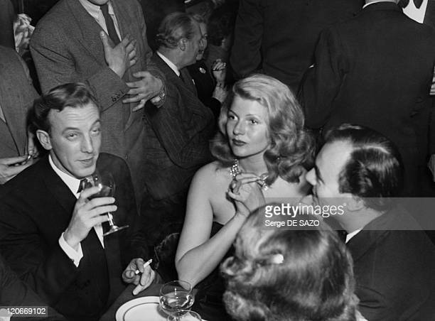 Rita Hayworth French fashion designer Jacques Fath and Ali Khan in Paris France in 1949