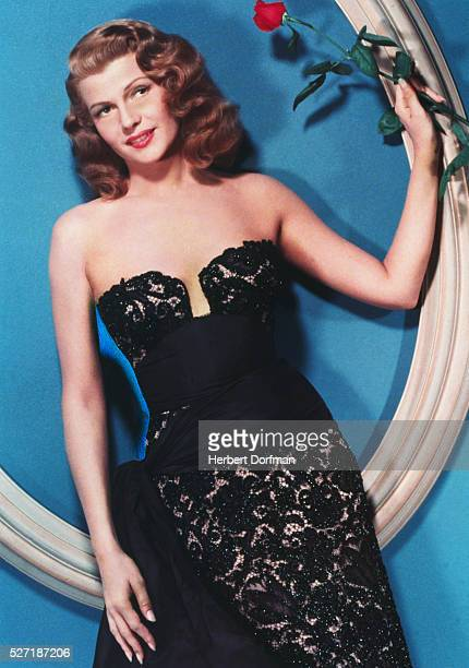 Rita Hayworth Holding Red Rose