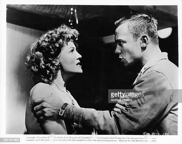 Rita Hayworth is grabbed by Aldo Ray in a scene from the film 'Miss Sadie Thompson' 1958