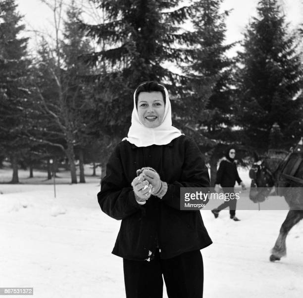 Rita Hayworth on holiday at Megeve in the French Alps with her daughters Yasmin and Rebecca, 30th January 1956.