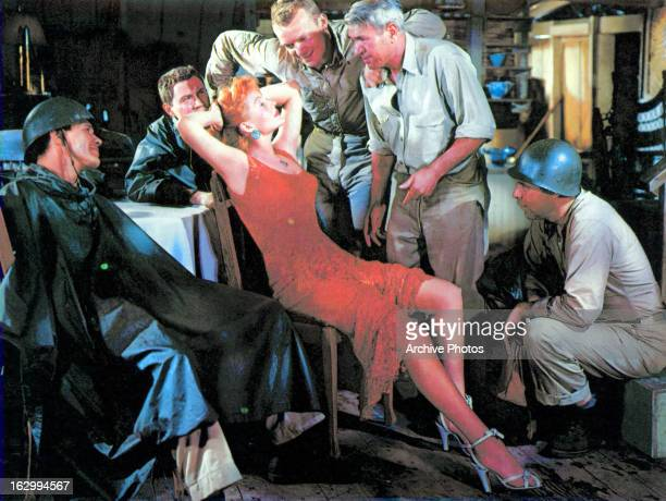 Rita Hayworth sits in front of Aldo Ray in a scene from the film 'Miss Sadie Thompson' 1953