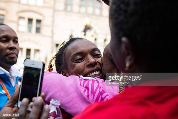 Rita Jeptoo a Kenya hugs fans after winning in the women's division of the Boston Marathon on April 21 2014 in Boston Massachusetts Today marks the...