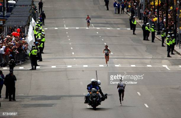 Rita Jeptoo of Kenya approaches the finish line followed closely by Jelena Prokopcuka of Latvia and Reiko Tosa of Japan during the 110th running of...