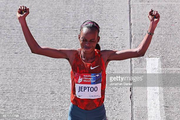 Rita Jeptoo of Kenya celebrates after winning of the 2014 Bank of America Chicago Marathon on October 12 2014 in Chicago Illinois