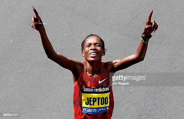 Rita Jeptoo of Kenya celebrates after winning the 118th Boston Marathon on April 21 2014 in Boston Massachusetts