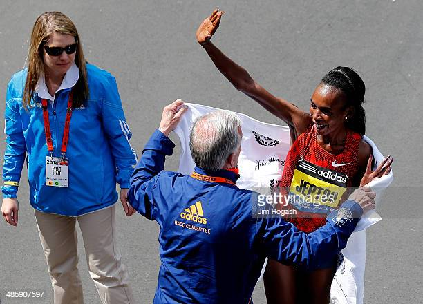 Rita Jeptoo of Kenya celebrates after winning the 118th Boston Marathon on April 21 2014 in Boston Massachusetts