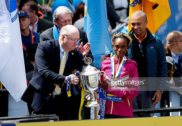 Rita Jeptoo of Kenya celebrates with the trophy after winning the 118th Boston Marathon on April 21 2014 in Boston Massachusetts