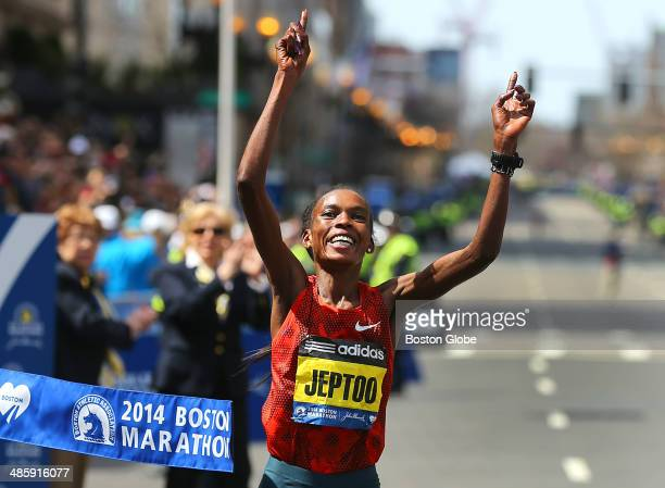 Rita Jeptoo of Kenya crosses the finish line to win first place and set a course record in the women's race of the 118th Boston Marathon on Monday...