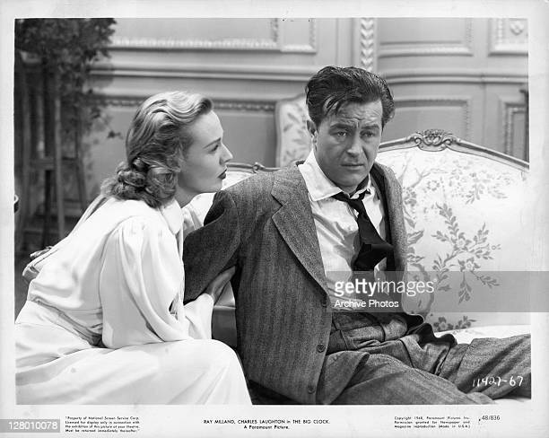 Rita Johnson And Ray Milland sit on sofa in a scene from the film 'The Big Clock' 1947