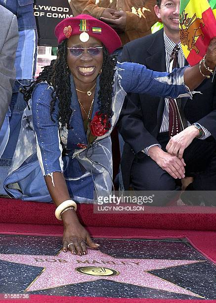 Rita Marley widow of Jamaican reggae star Bob Marley touches her late husband's star on the Hollywood Walk of Fame after it was unveiled to...