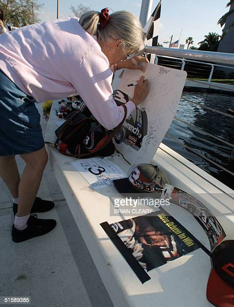 Rita McAtee of Indianapolis Indiana signs a sympathy card for NASCAR driver Dale Earnhardt outside of Daytona International Speedway in Daytona Beach...