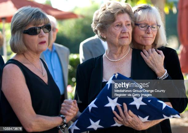 Rita Molletta is comforted by daughters Mary Wilson, left, and Helen Smith during funeral services for her husband Joseph Molletta in Irvine on...